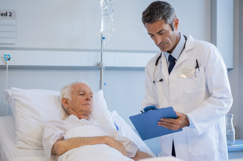 doctor reading medical reports